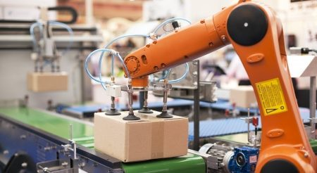 24969140 – packaging line with robotic arm at work